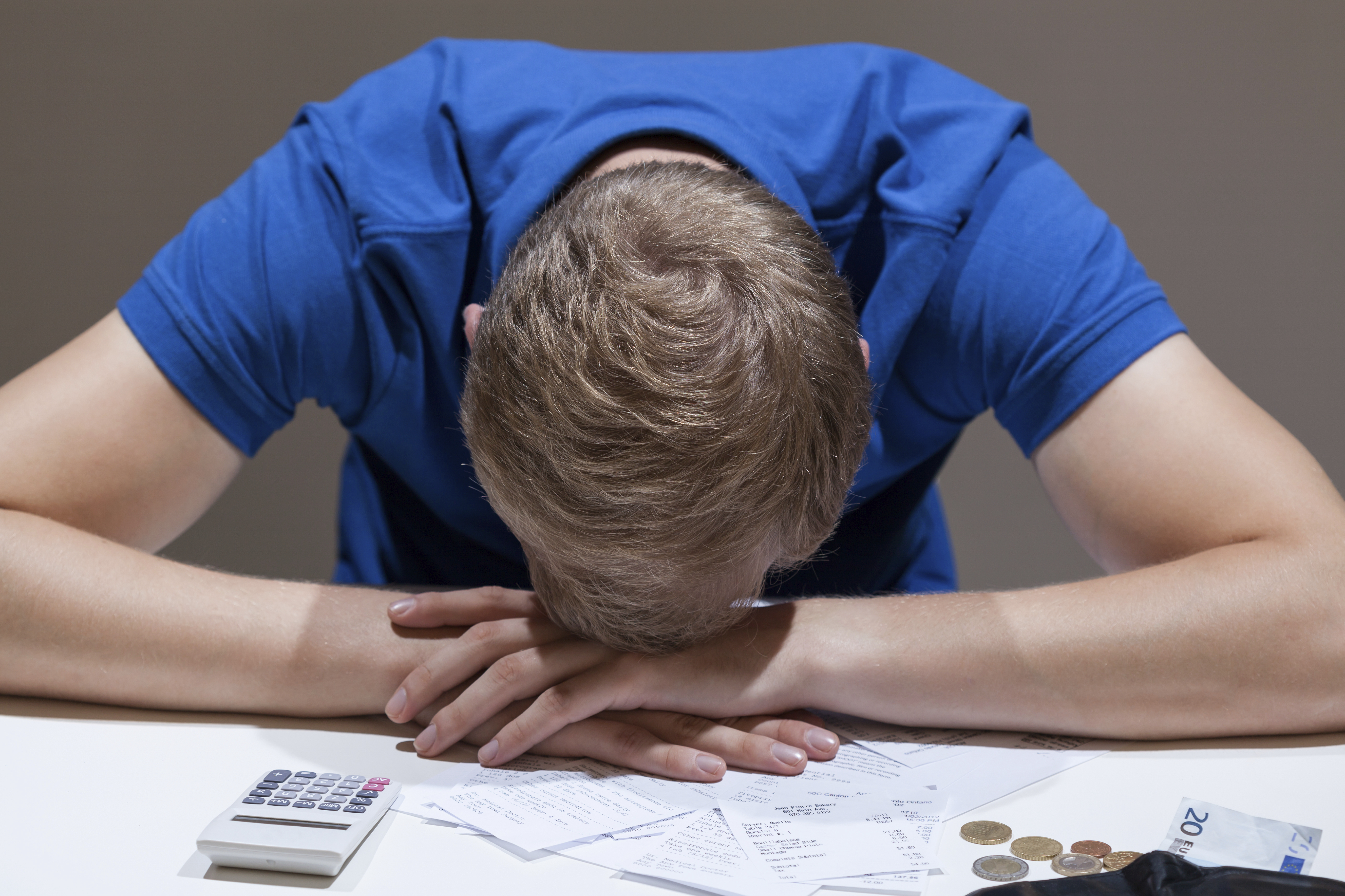 Frustrated man not having money to pay bills