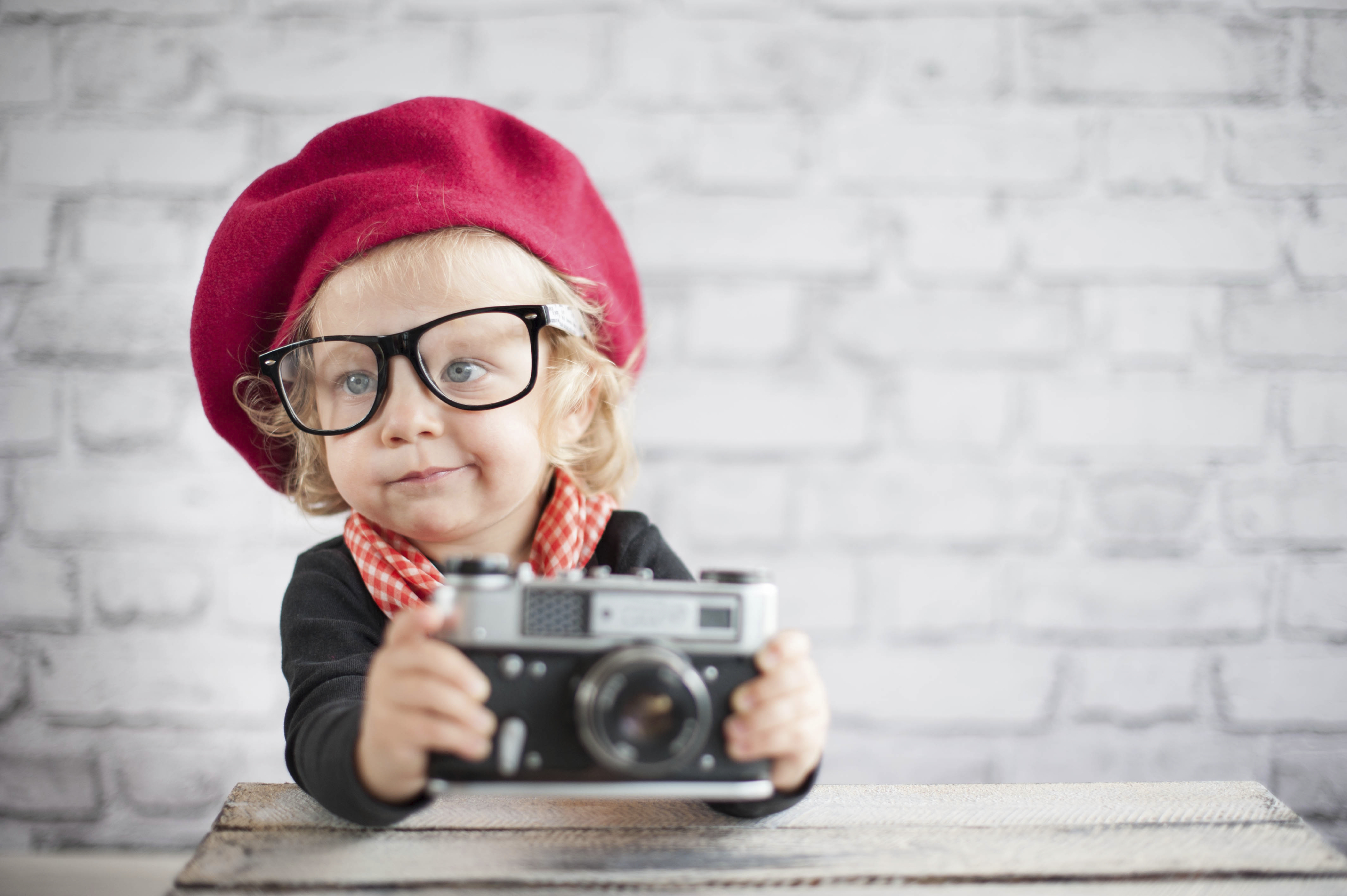Self expression Child with vintage camera